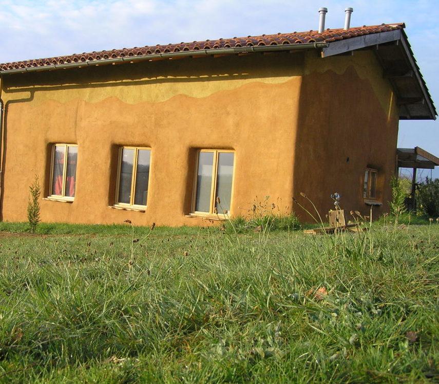 Achterkant huis + tuin